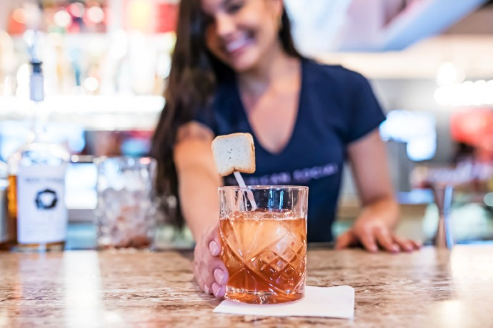 bartender serving PB&J Old Fashioned