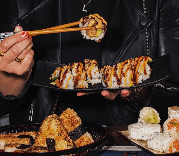 Kumi sushi rolls and chopsticks