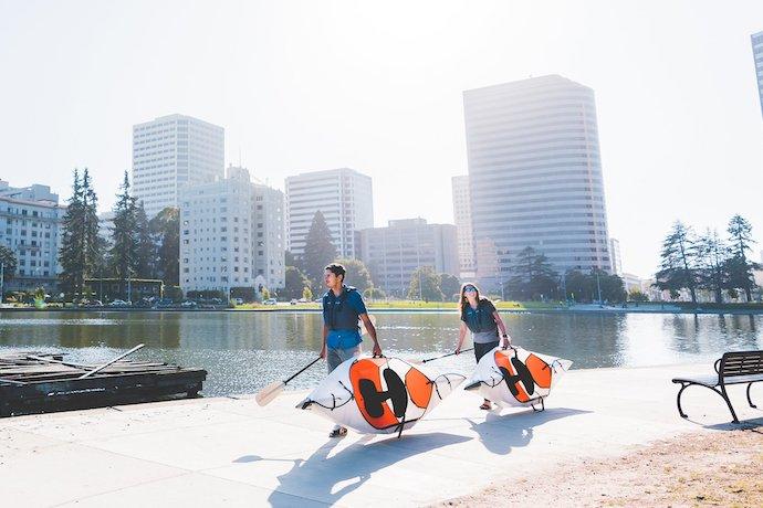 people carrying oru inlet kayak