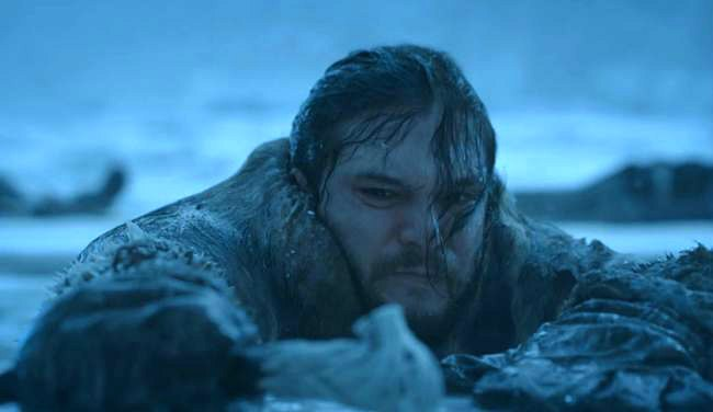 Jon Snow climbing out of water beyond the wall