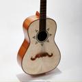A Handmade Mariachi Guitar: Necessary