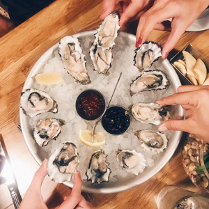 Dollar Oysters and Live Music. Sounds Like Someone's Birthday.