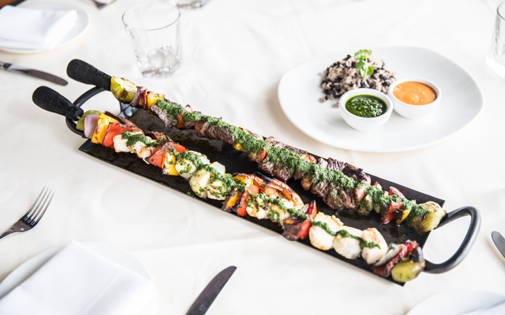 Steak, sausage and chorizo on giant skewers